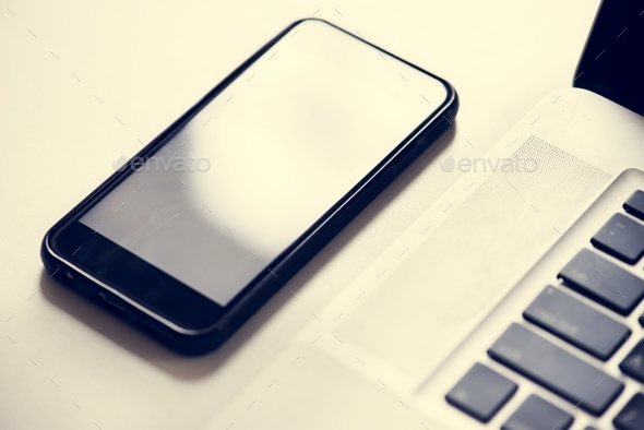 Smartphone and laptop gadget on the table - Stock Photo - Images