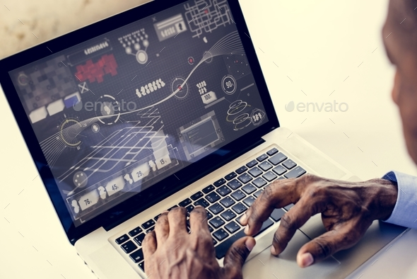 African ethnicity man working with infographic on laptop - Stock Photo - Images