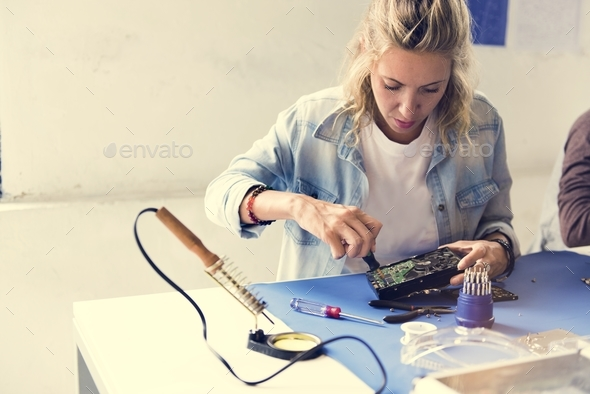 Caucasian technician woman using screw driver install a screw to HDD - Stock Photo - Images