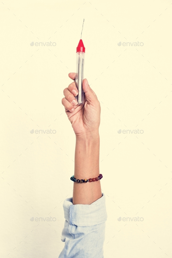 Hand holding equipment tool isolated on background - Stock Photo - Images