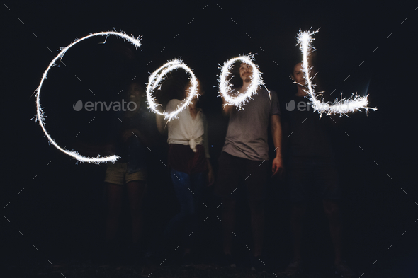 Sparklers forming the word cool - Stock Photo - Images