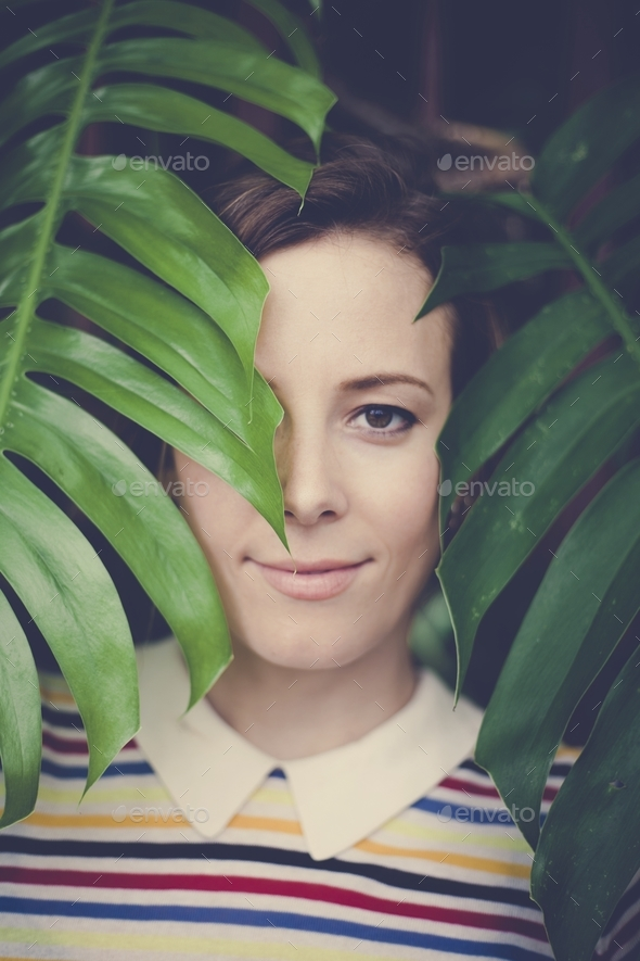 Portrait of caucasian beautiful woman with green leafs - Stock Photo - Images