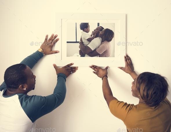 Black couple hanging fmily photo - Stock Photo - Images