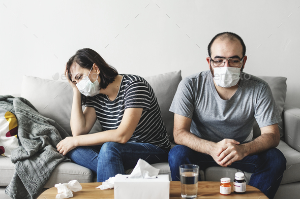 Couple sick at home on the sofa - Stock Photo - Images