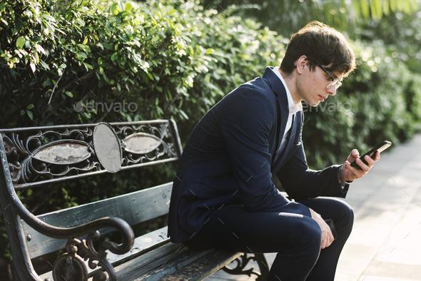 Businessman using phone - Stock Photo - Images
