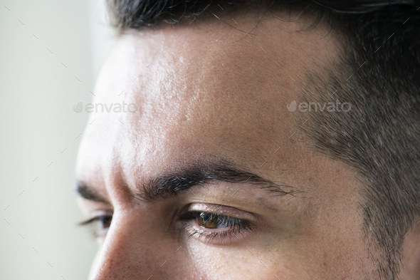 Side portrait of white man closeup on eyes - Stock Photo - Images