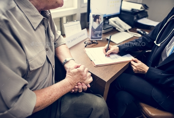 An elderly patient meeting doctor at the hospital - Stock Photo - Images