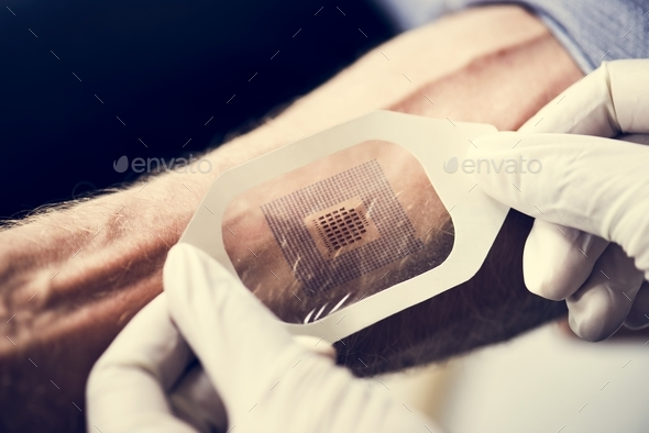Hands with gloves press a code scan on human arm - Stock Photo - Images