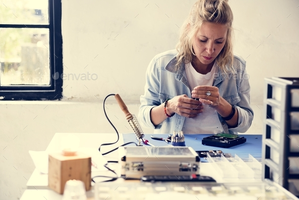 Technician working on computer hard disk - Stock Photo - Images