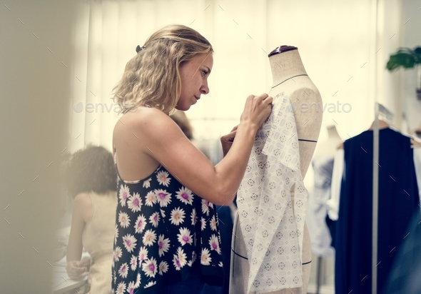 Customer checking out clothing shop - Stock Photo - Images