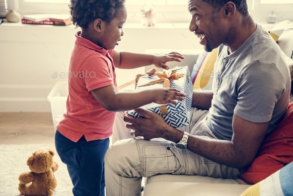 Father surprising her son with a present - Stock Photo - Images