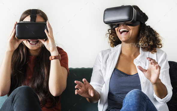 Women experiencing the virtual reality goggles - Stock Photo - Images
