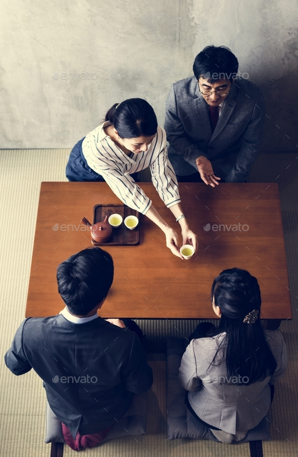 Japanese business people drinking tea - Stock Photo - Images