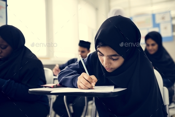 Muslim children studying in classroom - Stock Photo - Images