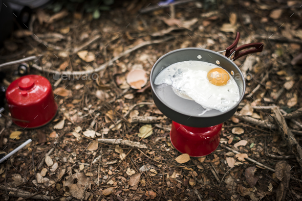 Fried egg on portable gas - Stock Photo - Images
