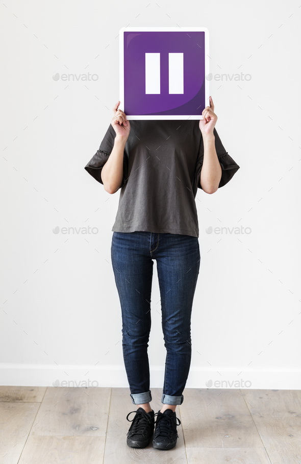 Girl holding a purple pause icon - Stock Photo - Images