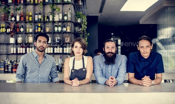 People at a bar counter - Stock Photo - Images