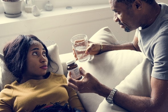 Husband taking care his sickness wife - Stock Photo - Images