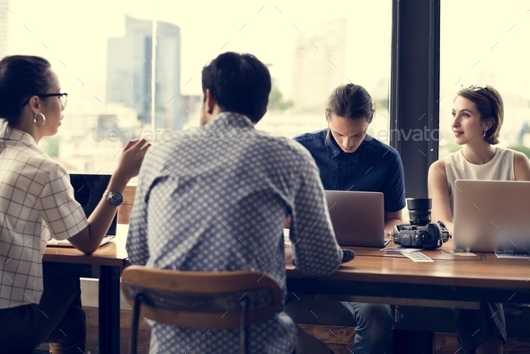 Group of business people in a meeting - Stock Photo - Images