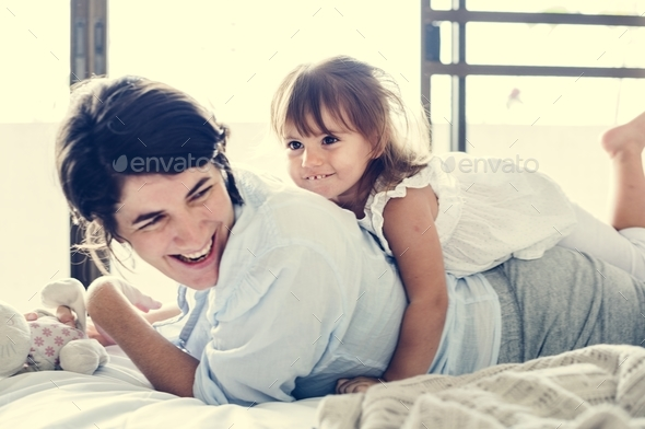 Mother and daughter playing together with happiness - Stock Photo - Images