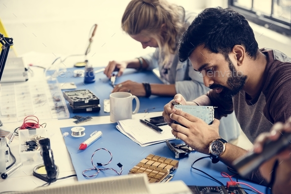 Electronics technicians team working on computer parts - Stock Photo - Images