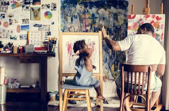 African descent artist dad giving his child a high five - Stock Photo - Images