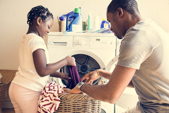 Dad and daughter houseworking together - Stock Photo - Images