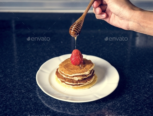 Closeup of pancake top with strawberry - Stock Photo - Images