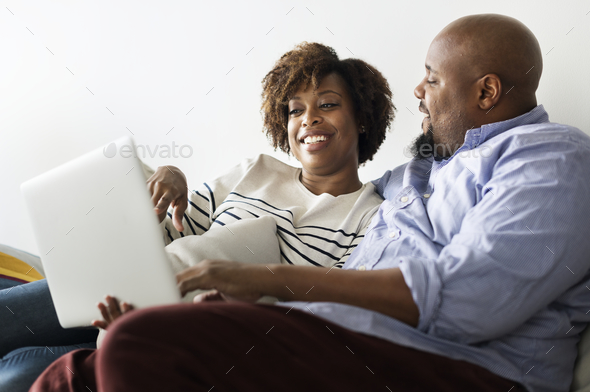 Happy couple relaxing at home - Stock Photo - Images