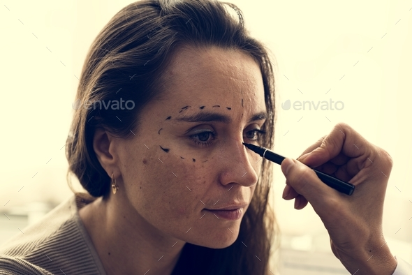 A woman is consulting about plastic surgery - Stock Photo - Images