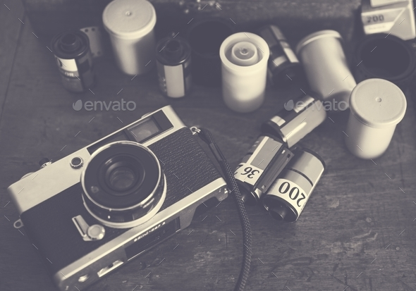 Closeup of film camera on wooden table - Stock Photo - Images