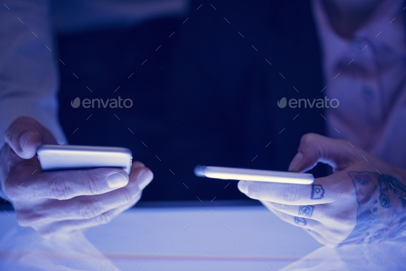 Hands holding smartphone gadget technology - Stock Photo - Images