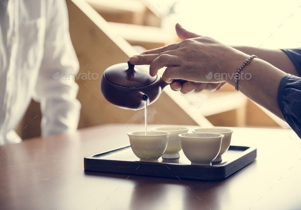 Pouring sake - Stock Photo - Images