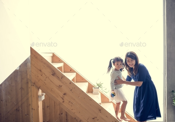Mother and daughter playing together - Stock Photo - Images