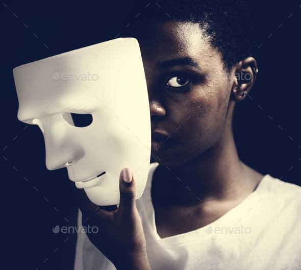 Black woman holding white mask - Stock Photo - Images