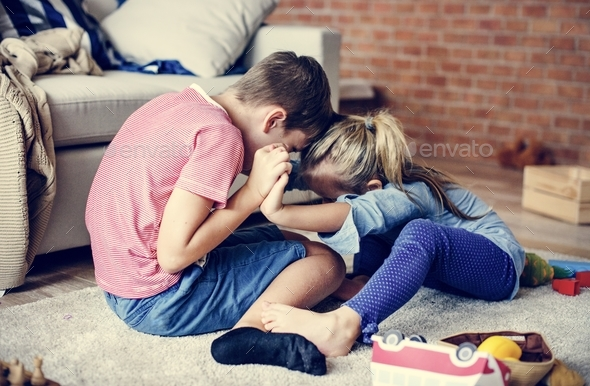 Siblings playing together - Stock Photo - Images