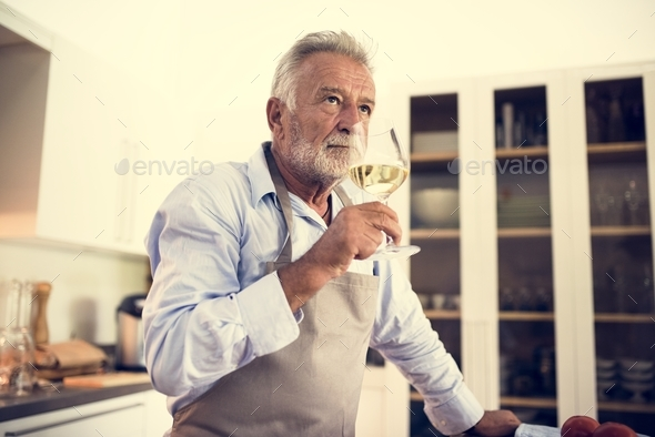 A man drinking a glass of wine - Stock Photo - Images