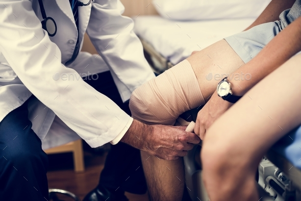 Doctor assisting a patient - Stock Photo - Images