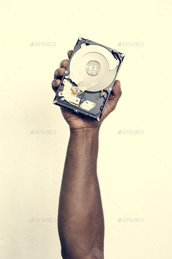Hand holding hard disk drive isolated on background - Stock Photo - Images