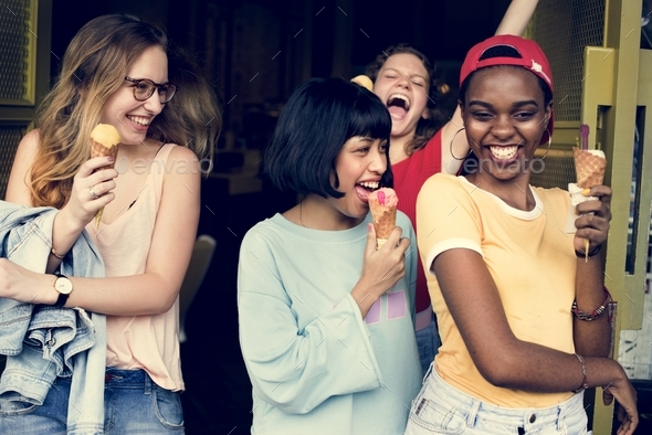 Group of diverse women eating ice cream together - Stock Photo - Images