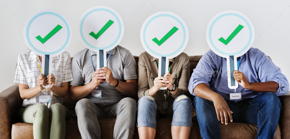 Group of people holding check icons - Stock Photo - Images