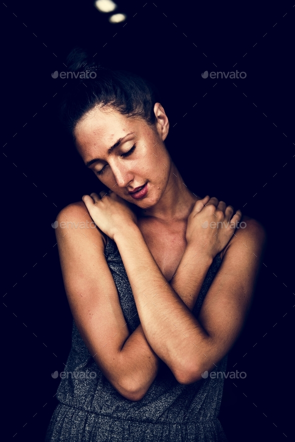 Woman hugging herself - Stock Photo - Images