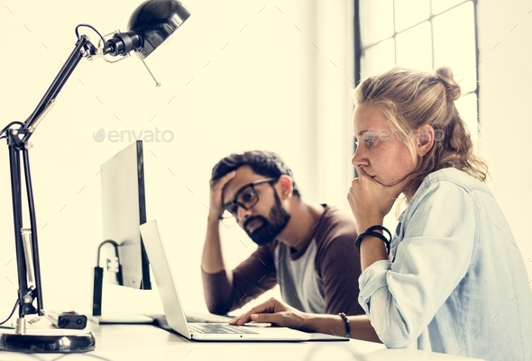 People thinking about to fix something on computer - Stock Photo - Images