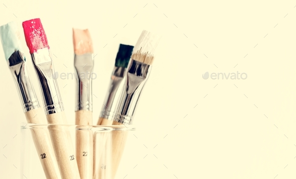 Paintbrush Art Tool in a Transparent Glass - Stock Photo - Images