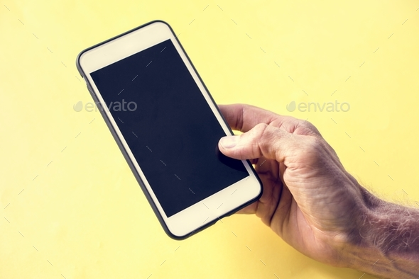 Hand holding smartphone isolated on background - Stock Photo - Images