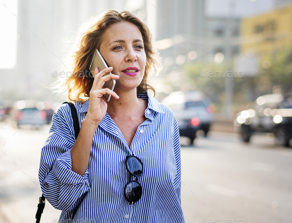Caucasian woman with a smartphone - Stock Photo - Images