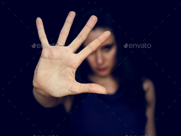 Woman showing her blank palm - Stock Photo - Images