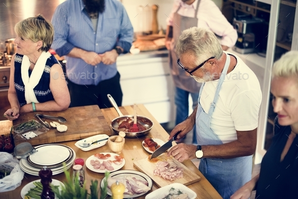 Group of friends are cooking in the kitchen - Stock Photo - Images