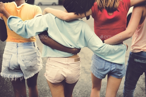 Rear view of a group of diverse woman friends walking together - Stock Photo - Images