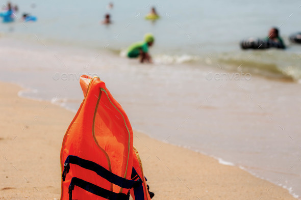 Life jackets on beach - Stock Photo - Images